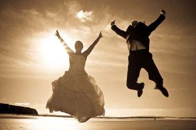 jumping_couple_sepia_backlit_shutterstock_64299340